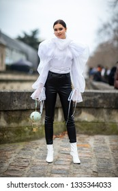 Paris, France - March 03 2019: Paris Fashion Week Street Style  Fall/Winter 2019/2020 Guest outside Valentino