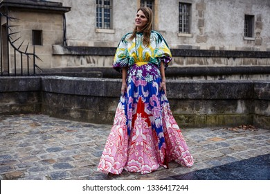 PARIS, FRANCE - MARCH 03, 2019: Anna Dello Russo wears a acolorful pleated dress seen before VALENTINO show during Paris Fashion Week Womenswear Fall/Winter 2019/2020