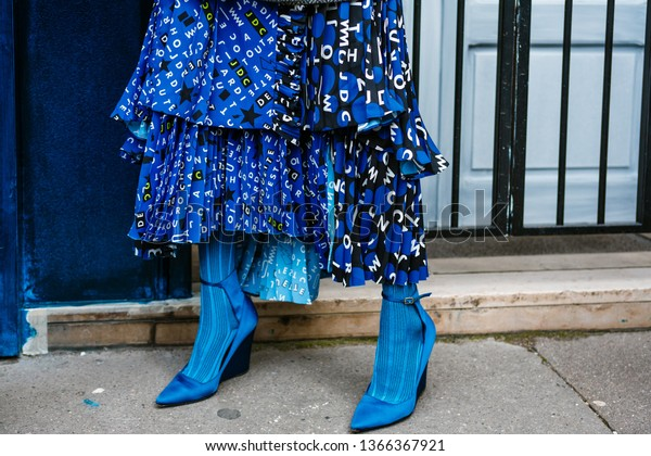 PARIS, FRANCE - MARCH 03, 2019: Fashion details of a guest's look seen before THOM BROWNE show, during Paris Fashion Week Womenswear Fall/Winter 2019/2020.