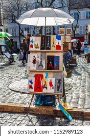 PARIS, FRANCE - MARCH 04, 2015: Artists easels and artwork set up in Place du Tertre in Montmartre. Montmartre attracted many famous modern painters in the early 20th century.