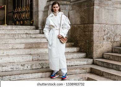 PARIS, FRANCE - MARCH 04, 2019: Model Giedre Dukauskaite wearing white trench coat seen before Stella McCartney, during Paris Fashion Week Womenswear Fall/Winter 2019/2020