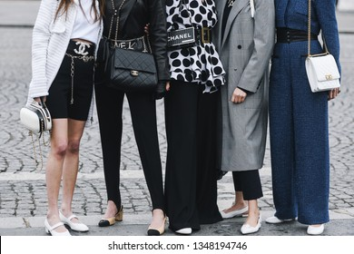 Paris, France - March 05, 2019: Street style outfit -  Models, bloggers and influencers with fashionable and stylish looking after a fashion show during Paris Fashion Week - PFWFW19