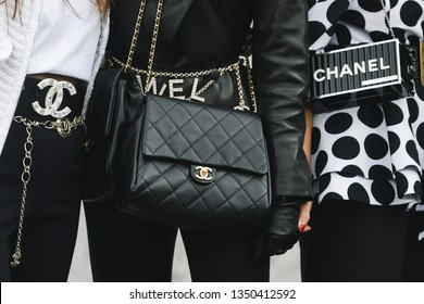 Paris, France - March 05, 2019: Street style outfit -  Woman wearing Chanel purse after a fashion show during Paris Fashion Week - PFWFW19