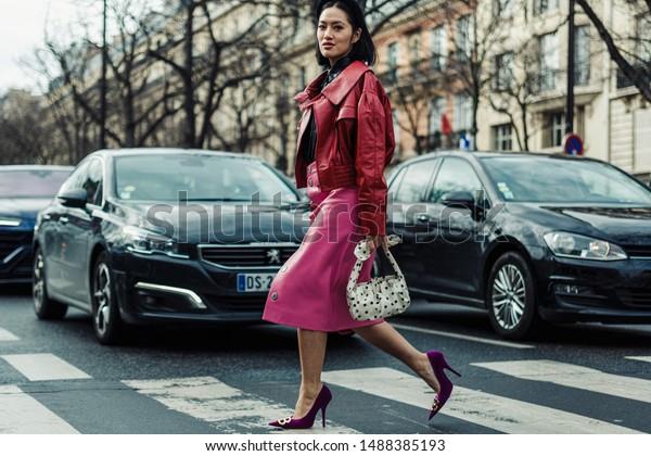 PARIS, FRANCE - MARCH 05, 2019: TIffany Hsu wearing red leather jacket and pink skirt seen outside MIU MIU show, during Paris Fashion Week Womenswear Fall/Winter 2019/2020.