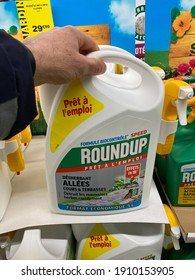 Paris, France - March 05, 2020 : Customer buying roundup in a french Hypermarket. The new Roundup is a brand-name of an herbicide without glyphosate, made by Monsanto Company.