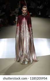 PARIS, FRANCE - MARCH 05: A model walks the runway during the Alexander McQueen show as part of Paris Fashion Week Womenswear Fall/Winter 2018/2019 on March 5, 2018 in Paris, France.