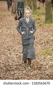 PARIS, FRANCE - MARCH 06: A model walks the runway during the Chanel show as part of the Paris Fashion Week Womenswear Fall/Winter 2018/2019 on March 6, 2018 in Paris, France.
