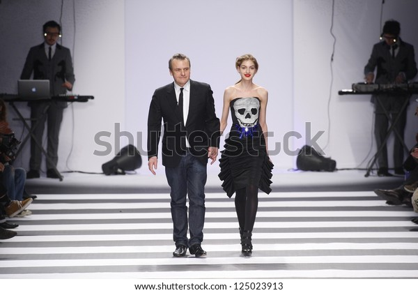 PARIS, FRANCE - MARCH 08: Designer Jean-Charles de Castelbajac and model walks the runway during his A/W 2011/2012 show in Paris Fashion Week at Pavillon Concorde on March 8, 2011 in Paris, France.