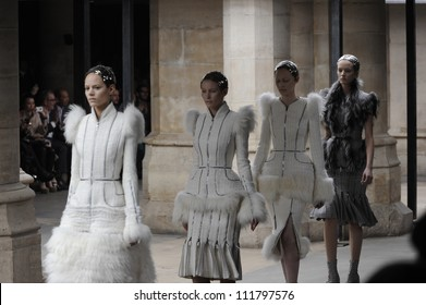 PARIS, FRANCE - MARCH 08: A model walks runway during the Alexander McQueen Ready to Wear Autumn/Winter 2011/2012 show during Paris Fashion Week at La Conciergerie on March 8, 2011 in Paris, France.