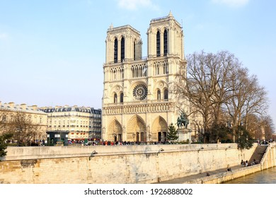 Paris , FRANCE - March 11 2016 : Beautiful Notre Dame Cathedral  in Paris, before the fire. Is a medieval Catholic cathedral, Gothic architecture.