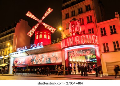 Paris, France - MARCH 15, 2015: The Moulin Rouge by night. Paris. France. Moulin Rouge is a famous cabaret, locating in the Paris red-light district of Pigalle. Travel (vacation) concept.