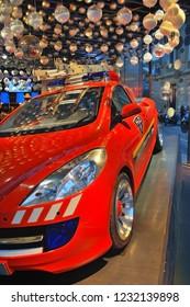 PARIS, FRANCE - MARCH 16, 2014: Peugeot avenue champs elysées. Peugeot car. Peugeot is a French cars brand, part of PSA Peugeot Citroen