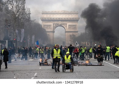 "Paris, FRANCE - March, 16 2019 : Protesters yellow vests ""Gilets Jaunes"" a Paris on Champs Elysees during a demonstration to protest against policy of french government."
