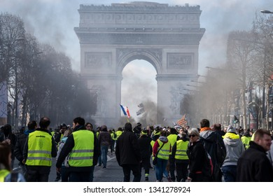 "Paris, FRANCE - March, 16 2019 : Protesters yellow vests ""Gilets Jaunes"" at Paris on Champs Elysees during a demonstration to protest against policy of french government."