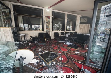 """Paris, FRANCE - March, 16 2019 : Inside the restaurant the Fouquet's after it's vandalizing during a demonstration of yellow vest """"Gilets jaunes"""" on Champs Elysees at Paris."""