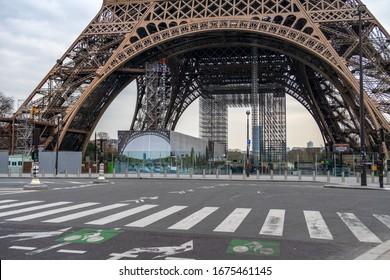 Paris, France - March 17 2020: Coronavirus Lockdown in Paris. Nobody in front of the Eiffel tower.