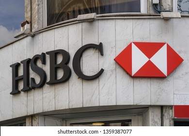 Paris, France - March 18, 2019: HSBC sign outside a branch. British-based multinational banking and financial services company headquartered in London, it is the world's fourth largest bank