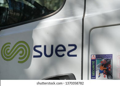 Paris, France - March 19, 2019: SUEZ emblem. Suez Environnement SA is a French-based utility company which operates largely in the water treatment and waste management sectors