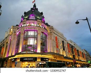 paris, france - march 2 2019 :  facade of the BHV shop building in the Marais district. evening light.