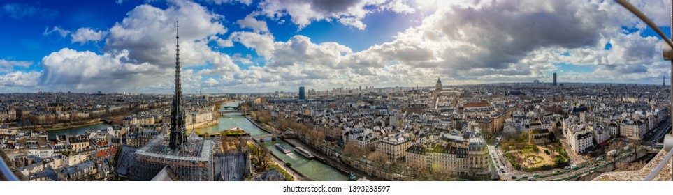 Paris, France, March 2019: Aerial ultra wide Panorama cityscape of Paris. Skyline and famous landmarks central downtown buildings in the French capital. It is very popular European tourist destination