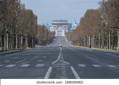 PARIS, FRANCE March 22th 2020 : The Arc de Triomphe, Triumphal arch, sighted from Champs Elysées empty during the period of containment measures  due to the Covid-19 Coronavirus.