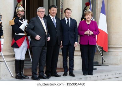 PARIS, FRANCE - MARCH 25, 2018 : Emmanuel Macron, Angela Merkel and Jean-Claude Juncker welcoming  chinese President Xi Jinping for his state visit in France at the Elysee Palace.