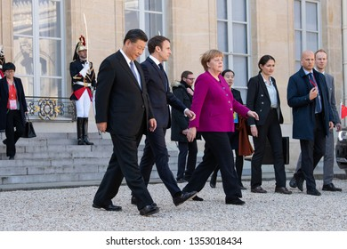 PARIS, FRANCE - MARCH 25, 2018 : Emmanuel Macron, Angela Merkel and Xi Jinping  walking  in the courtyard of Elysee Palace during the state visite of the chinese President in France.