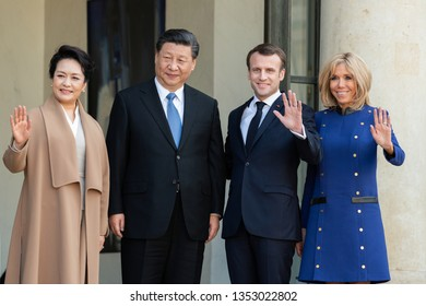PARIS, FRANCE - MARCH 25, 2018 : Emmanuel Macron and his wife Brigitte Macron welcoming  chinese President Xi Jinping and his wife Peng Liyuan for thier state visit in France at the Elysee Palace.