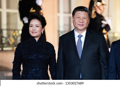 PARIS, FRANCE - MARCH 25, 2018 : Chinese President Xi Jinping and his wife Peng Liyuan for diner and state visit in France at the Elysee Palace with french president.