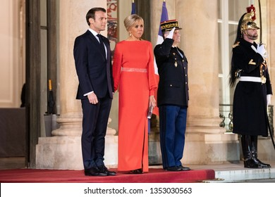 PARIS, FRANCE - MARCH 25, 2018 : Emmanuel Macron and his wife Brigitte Macron welcoming  chinese President and his wife for diner and state visit in France at the Elysee Palace.
