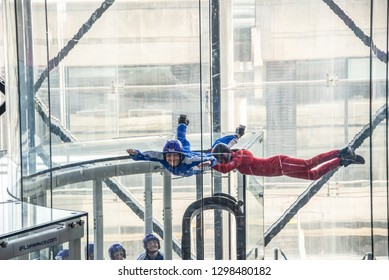 PARIS, FRANCE - March 25: Skydivers in indoor wind tunnel, free fall simulator on march 24, 2018 in Paris, France