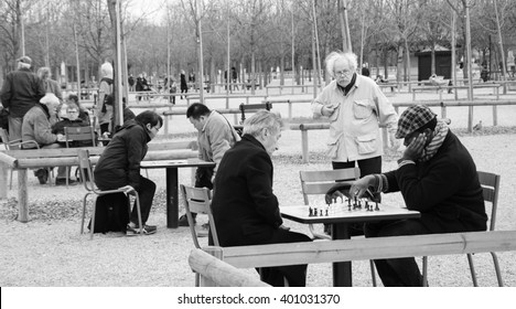 PARIS, FRANCE - MARCH 26, 2016: People playing chess in Jardin du Luxembourg (Luxembourg Garden). Luxembourg Garden is one of the most popular Parisian parks.