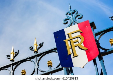 Paris, France - March 27, 2017: Gate with golden decoration and french flag. Predidential elections concept