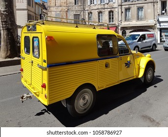 "Paris, France - march 29, 2017:The car delivery van delivery mail stamp of the Citroen 2cv yellow-colored color rides along the street of the ancient city. Car from the french camedy movies:""Visitors"""