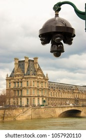 Paris (France), March 29, 2018. Dome of videoprotection cameras, with the Louvre museum in the background blurred.