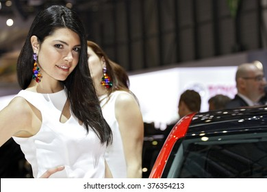 Paris, France - March 2nd: Beautiful hostess by the car on Geneva Motor Show on March 2nd, 2010 in Geneva.