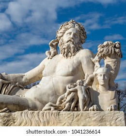 Paris, France - March 30, 2017: A statue of the Colossus Nile in the Jardin des Tuileries in Paris against a bright blue sky with white clouds, France