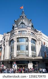 Paris, France - March 30, 2019: Crowd in front of Bazar de l'Hotel de Ville (BHV) entrance. BHV is a popular department store in Le Marais.