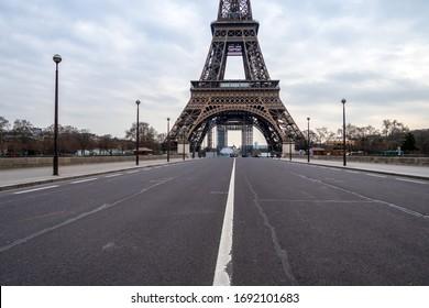 Paris, France - March 30 2020: Empty Iena bridge in front of Eiffel Tower during Coronavirus Lockdown in Paris.