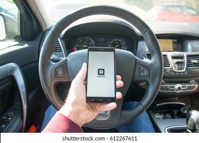 Paris, France, march 31, 2017: Driver starting uber application with new logo