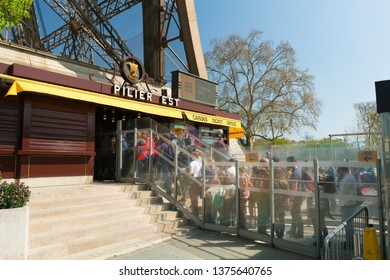 Paris, France - March 31, 2019: Tourists are waiting in line for an elevator lift to the Eiffel Tower