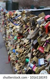 """PARIS, FRANCE - MARCH 31st, 2013 : Love padlocks of the famous lovers bridge named """"Pont des Arts"""""""