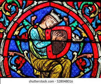 PARIS, FRANCE - MARCH 4, 2011: Stained glass window in the Notre Dame Cathedral in Paris, depicting King David playing on his Harp.
