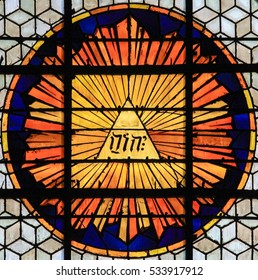 PARIS, FRANCE - MARCH 4, 2011: Stained Glass in Church of Saint-Germain-des-Pres in Paris, depicting the tetragrammaton, the Hebrew theonym used as one of the names of God in the Hebrew Bible