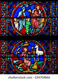 PARIS, FRANCE - MARCH 4, 2011: Stained Glass in Notre Dame Cathedral of Paris depicting scenes in the Life of Saint Joseph, husband of Mary, Mother of Jesus