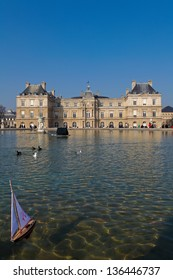 PARIS, FRANCE - MARCH 4: Small boat on the pond at Luxembourg Palace and Gardens in the center of Paris, France, on March 4, 2011. This building houses the French Senate.