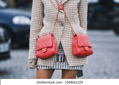 Paris, France - March 5, 2019: Street style - Woman wearing Blazer jacket, double red Chanel bags before a fashion show during Paris Fashion Week - PFWFW19