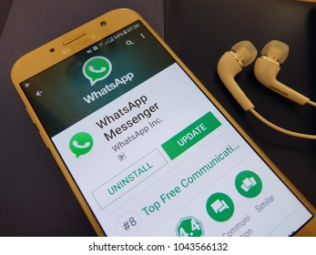 Paris, France. March 6, 2018: whatsapp messenger app on an android smartphone screen with earphones.