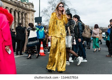 PARIS, FRANCE - MARCH 6, 2018: A guest after CHANEL show at Paris Fashion Week Fall / Winter 2018-2019