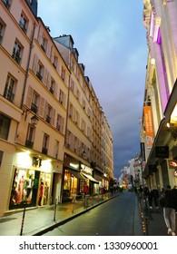 paris, france - march 6 2019 : rue du Temple (street Temple) in the district Marais. evening light. along the BHV shop.